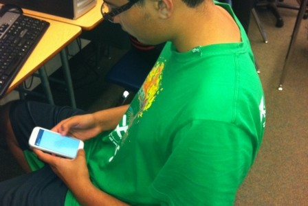Senior Parnoor Khinda uses a cell phone to do research during class.