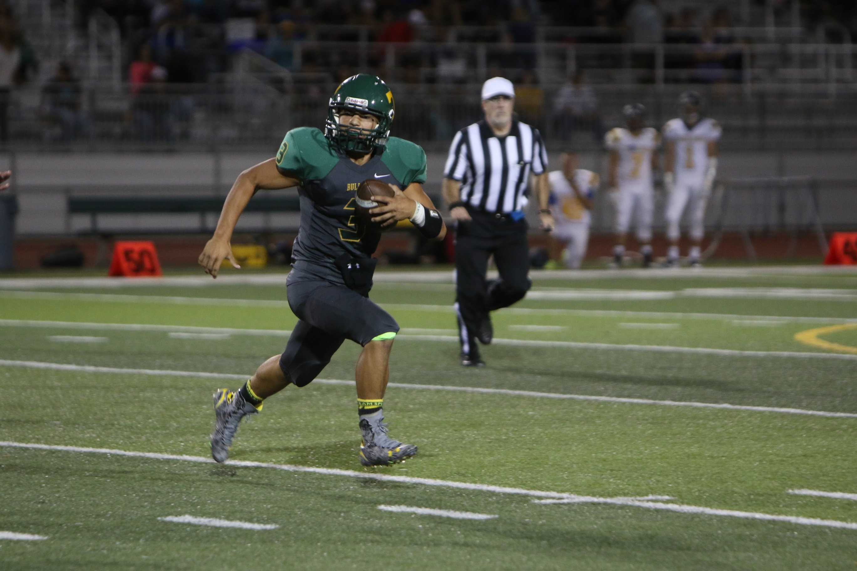Tracy quarterback Josh Alvarado scrambles for yards during game against Turlock.