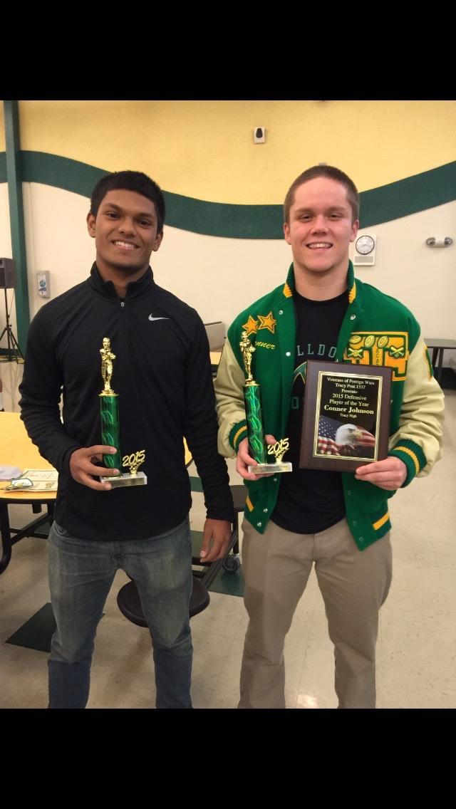 Senior Connor Johnson poses with Junior Soham Gupta at the varsity awards banquet.