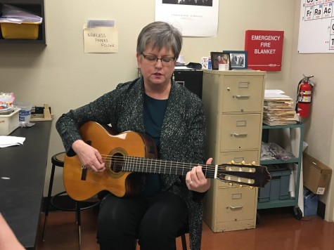 Science teacher Sally Hutsell performs a song