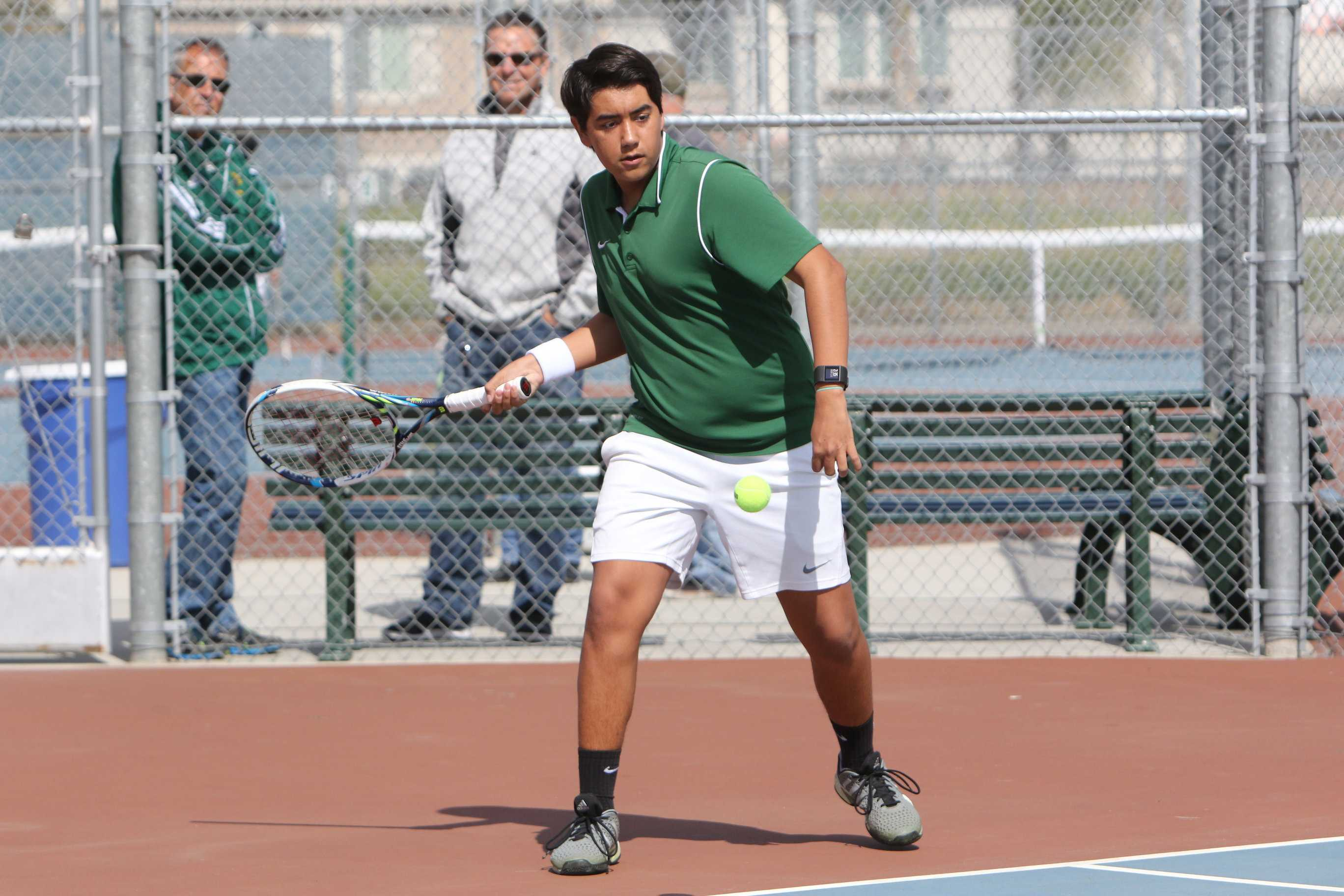 Tracy High senior Eric Louwerens plays Kimball at the team's match on March 14.
