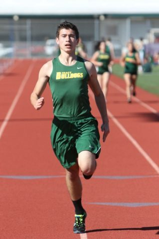 Senior Daniel Falco sprints out the last few meters in his race