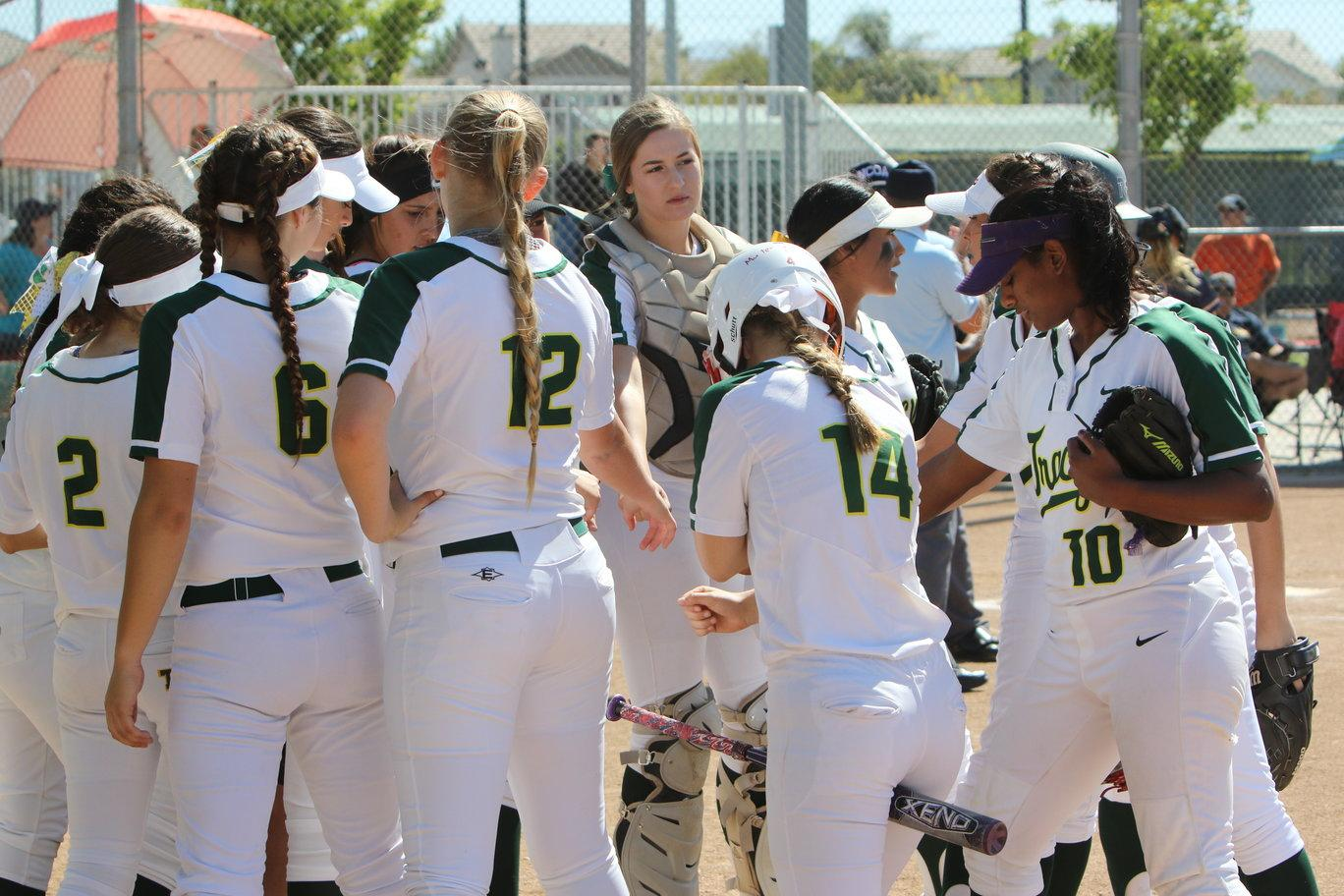 Tracy High softball team getting a team break before the inning starts.