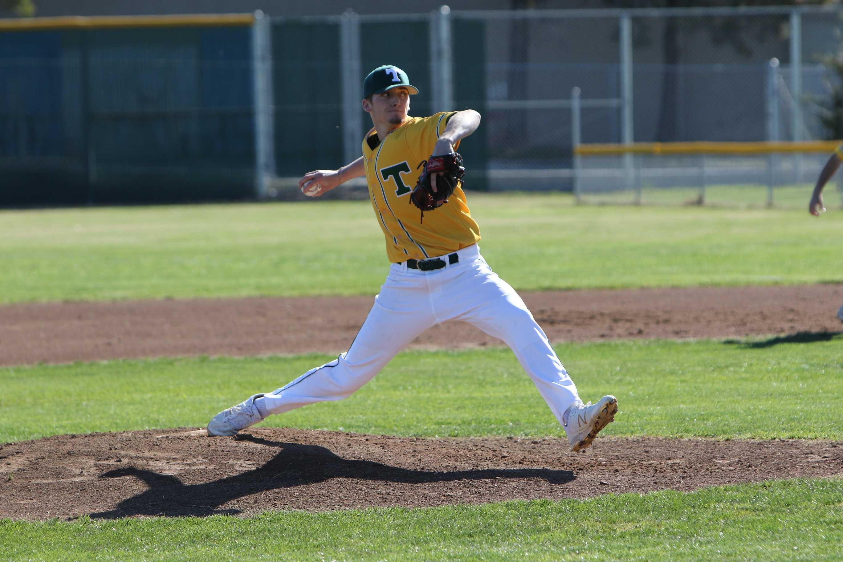 Junior Cody Bolton pitching against Enochs High.