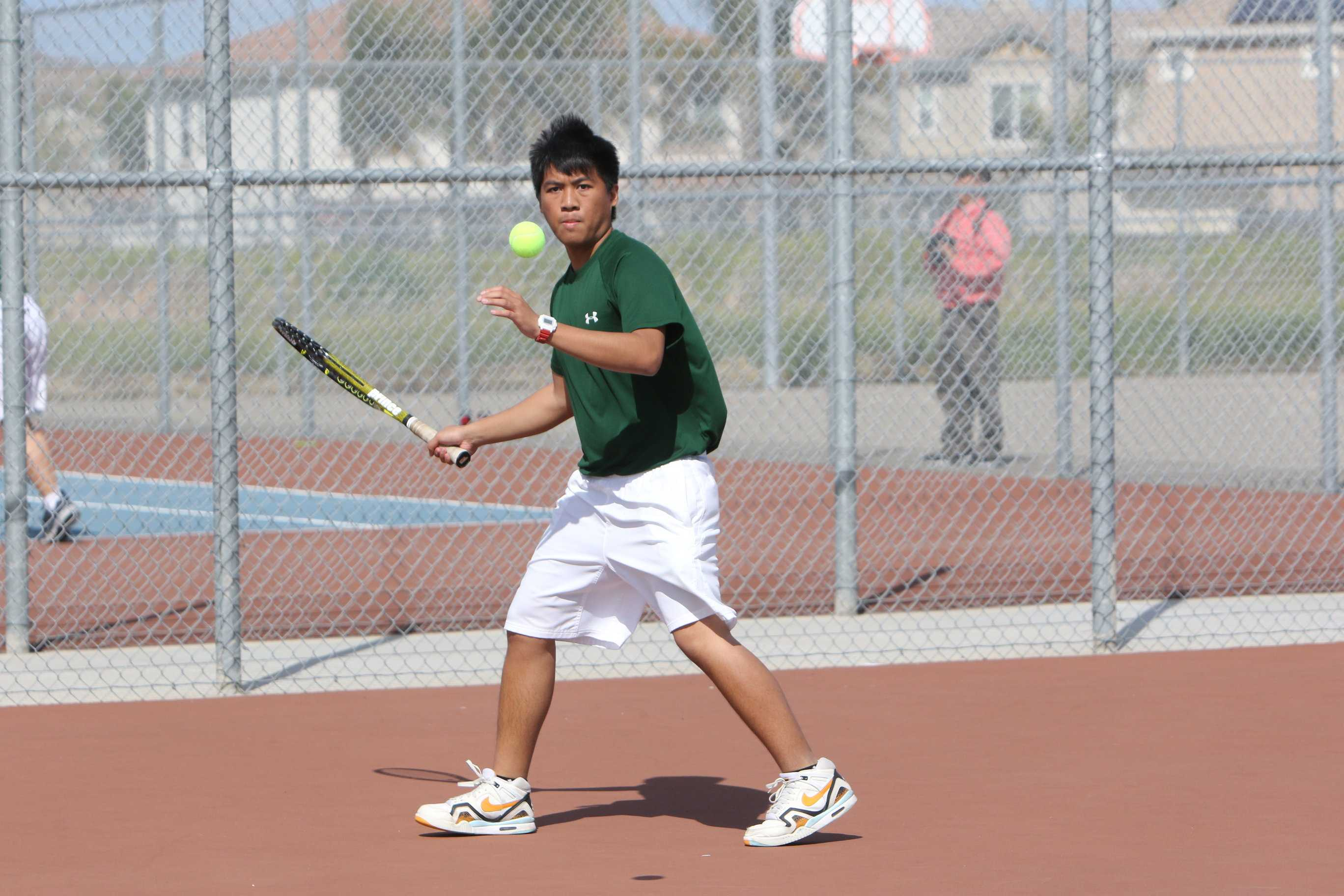 Senior Jeane Taruc gets ready to hit the ball back to Kimball's side of the court on Mar. 14.