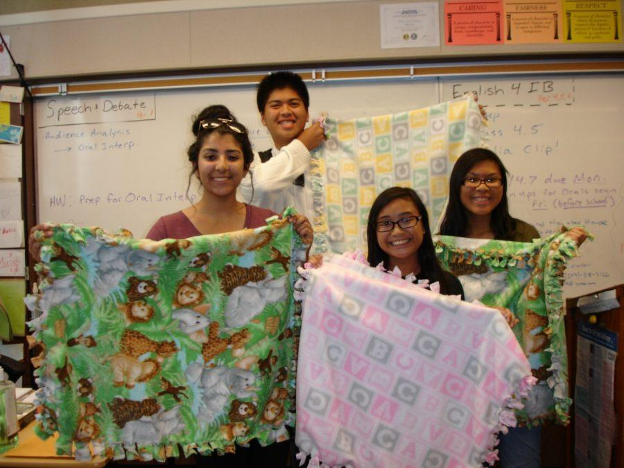 Key+Club%E2%80%99s+seniors%2C+Huda+Nauman%2C+Abi+Pineda%2C+Errold+Alba%2C+and+Jenna+Valenzona+proudly+hold+the+blankets+they+created+to+donate+to+babies+in+need.+