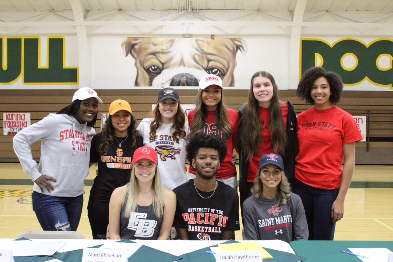 Tracy High's Fall 2018 NLI signing athletes get close for a group shot.