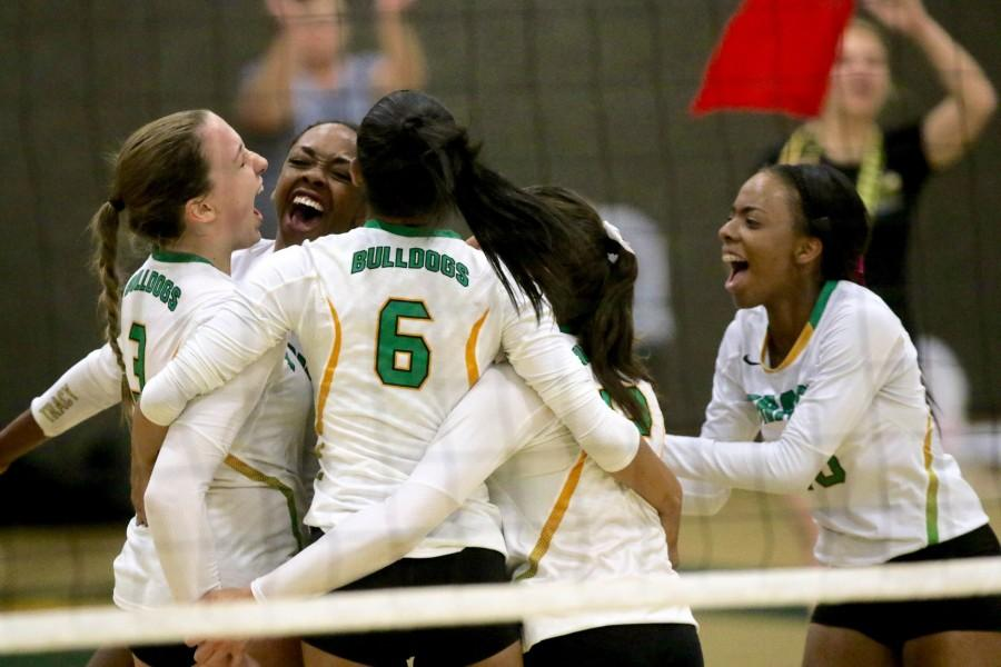 Tracy volleyball players celebrate after win against St. Mary's on Oct .21.
