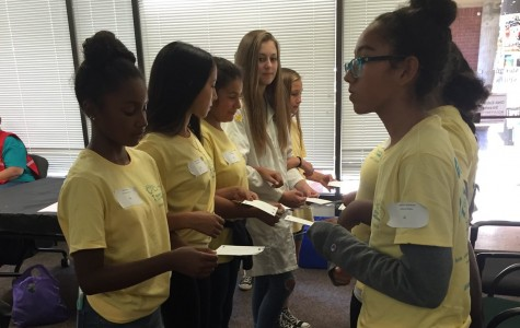 Biotech students encourage younger females to pursue science