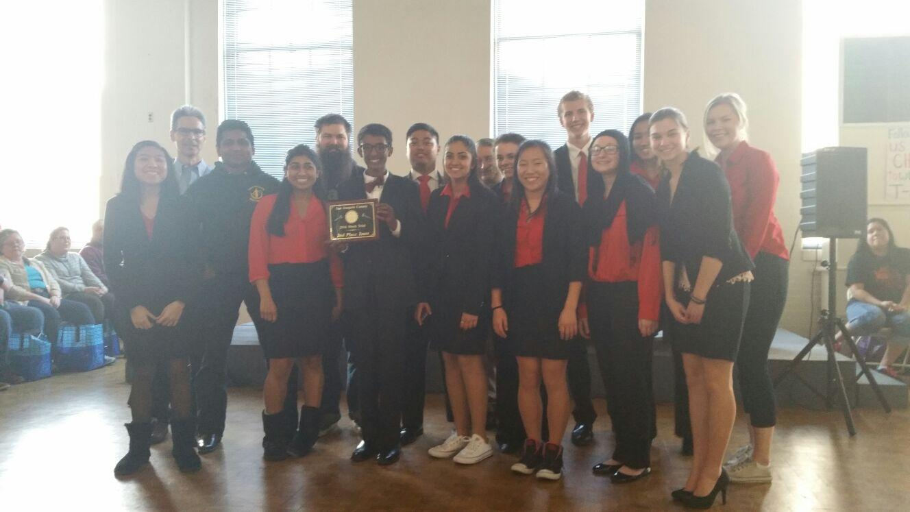 The 2015-2016 Mock Trial team poses for a quick picture with their award after finishing second in the San Joaquin County Competition.