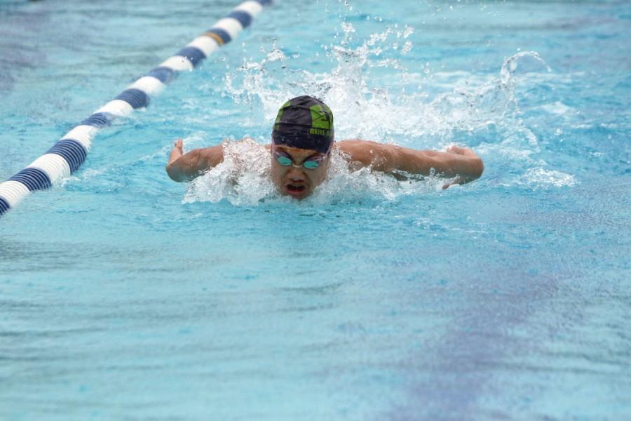 Senior Nathan Hu swims at practice meet.