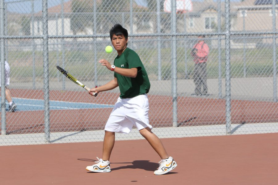 Senior+Jeane+Taruc+gets+ready+to+hit+the+ball+back+to+Kimball%27s+side+of+the+court+on+Mar.+14.