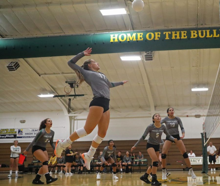 Natalie Laiolo leaps to spike the ball during another victory.