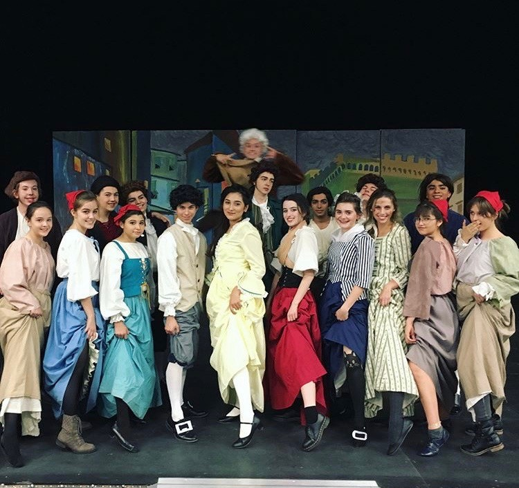 The cast poses for a picture.