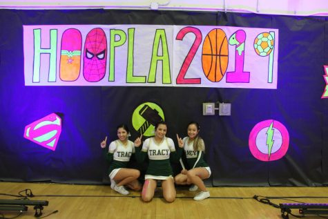 Varsity team members Maddison, Gianna and Amanda pose for a quick picture before the rally